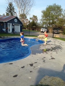 The boys jumping into pool
